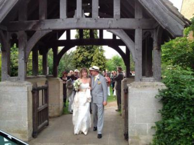 Bride and Groom leave through the Lych Gate